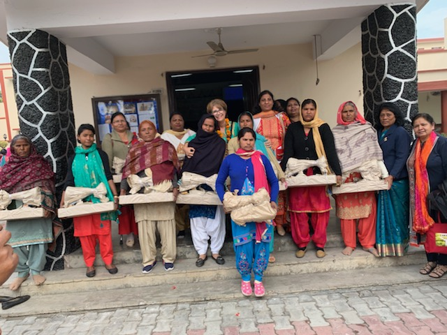 Ten women are thrilled with their new sewing machines
